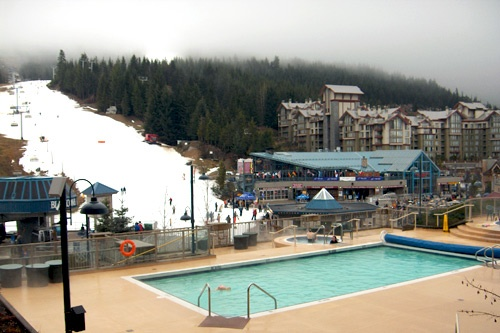 Pool and ski slopes at the Pan Pacific Whistler Mountainside in Whistler, British Columbia.
