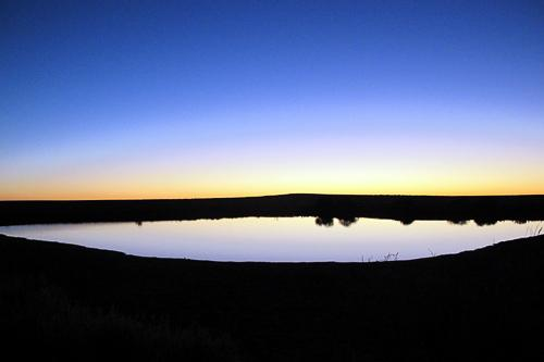 Sunset over an Artesian Dam on Anna Creek Station.