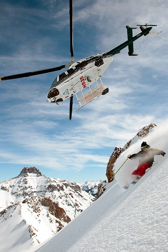 A helicopter guides a skier through Telluride's peaks. Courtesy Telluride Helitrax