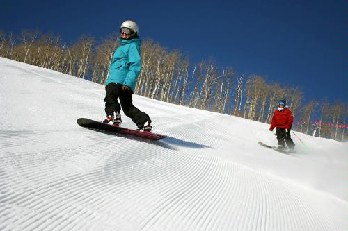 Snowboarding and skiing the slopes at Park City Mountain Resort in Park City, Utah.