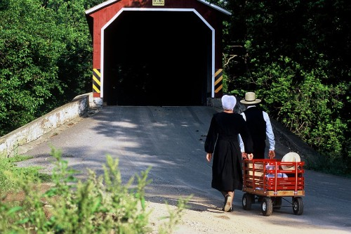 Amish family and covered bridge, Lancaster.
