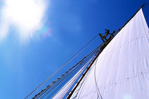 A mate scans Maine's waters from the crow's nest aboard the schooner American Eagle.