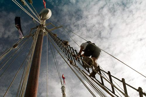 Second mate Bethany McNelly climbs the rigging of the schooner Timberwind.