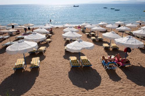 Pefkos and other once-quiet stretches of sand are now popular European getaways. Rhodes, Greece.