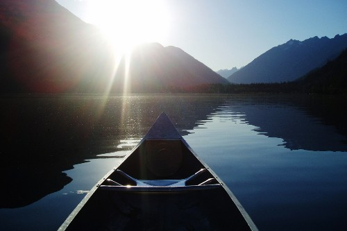 Canoeing on Lake Chelan, near Stehekin in North Cascades National Park.