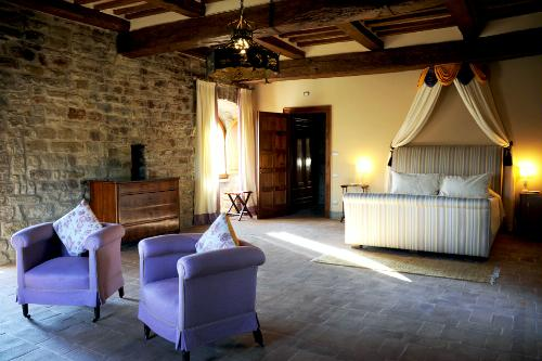 Guest room at Castello Bonaparte, a Medieval castle surrounded by a large loop of the Chiascio River, in Gubbio.
