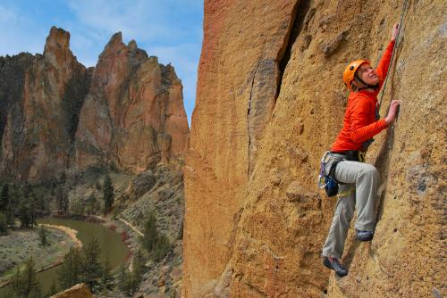 A woman rock climbing at Smith Rock State Park located outside Eugene, Oregon