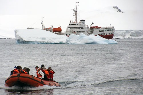 "In accordance with existing IAATO codes, no more than 100 passengers from any one cruise ship can set foot on Antarctic land at the same time. Visitors typically take small Zodiac boats to shore, where they are forbidden both from leaving anything behind, and from disturbing the local wildlife. Visit <strong><a href=""http://www.iaato.org/visitors.html"" target=""_blank"">www.iaato.org/visitors.html</a></strong> for a full list of IAATO visitor guidelines."