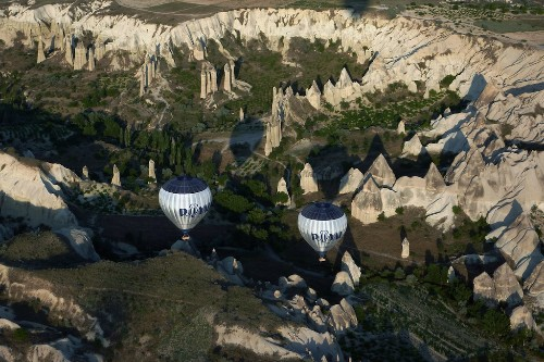 Hot air balloons over the otherworldly landscape of Cappadocia, Turkey.