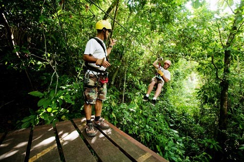 The Montezuma Waterfall Canopy Tour in Guanacaste takes visitors swinging through the treetops around the famous cascade.
