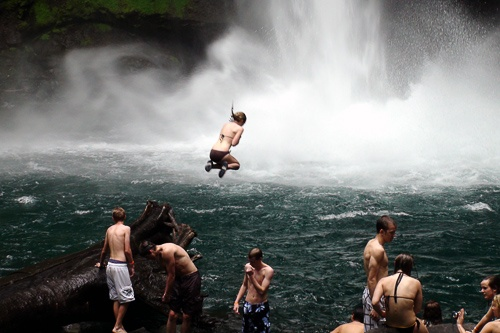 Diving into waters beneath a waterfall at La Fortuna in Costa Rica.