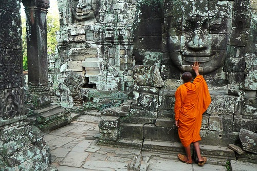 "A monk at Angkor Wat in Siem Reap, Thailand. Photo by <a href=""http://www.frommers.com/community/user_gallery_detail.html?plckPhotoID=61f45d4d-5dcc-4e9e-af2b-c8e987f9f240&plckGalleryID=c0482941-0d2d-4cca-b8c4-809ee9e20c72"" target=""_blank"">dkosta/Frommers.com Community</a>"