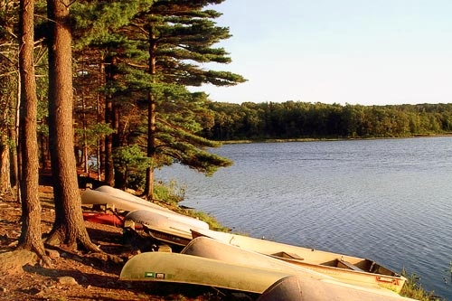 Canoes lined up along the lake at Promiseland State Park in the Poconos. Courtesy Pocono Mountains Visitors Bureau