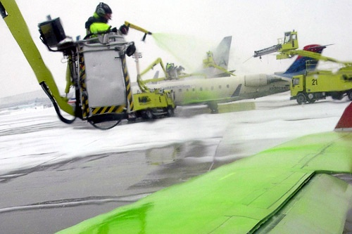 Deicing a plane in Montreal.