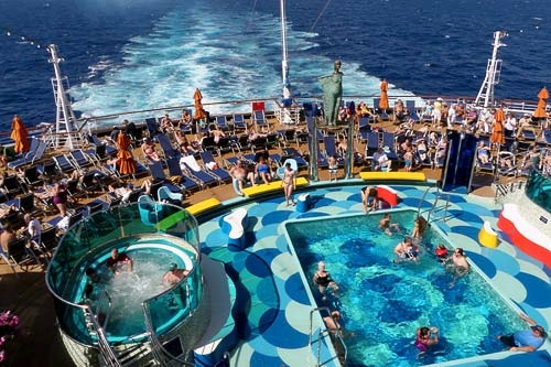 Lounging in a pool aboard Carnival Dream.