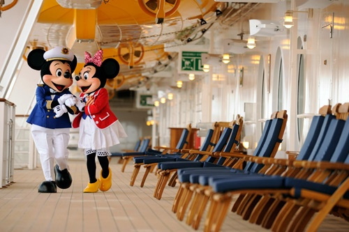 """Captain"" Mickey Mouse and ""First Mate"" Minnie Mouse stroll the promenade deck. Photo by Disney Cruise Line/Diana Zalucky"