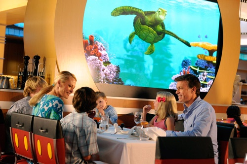 A suspiciously good-looking family dines at the Animator's Palate. Photo by Disney Cruise Line/Preston Mack