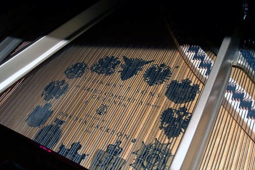 A detailed shot of the Steinway piano aboard Oceania's Marina.