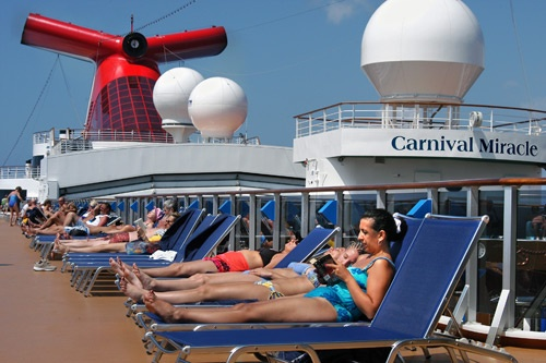 Sunbathers on the lido deck aboard Carnival Miracle. Photo: Carnival Cruise Lines