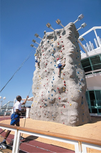 Passengers climbing the rock wall on Royal Caribbean's Monarch of the Seas. Photo: Royal Caribbean International
