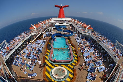 Guests aboard Carnival Cruise Lines' Sensation enjoy the pools, whirlpools and deck lounges on Lido Deck. Photo: Carnival Cruise Lines