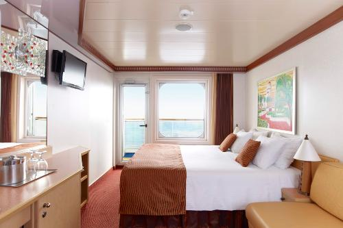 The stateroom of the Carnival Dream offers a balcony view of the ocean.
