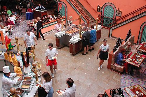 Passengers lining up for a fine meal at one of the Carnival Victory's many dining options.