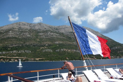 French flag aboard L'Austral at sea.