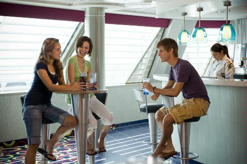 Teens visit the X Club drinking sodas and bottled water on the Celebrity Solstice.