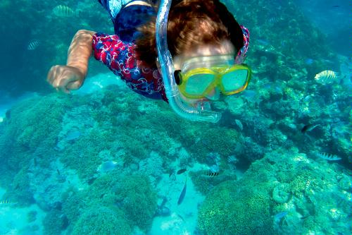 A young traveler on Paul Gauguin Cruises snorkels in French Polynesia as part of the Ambassadors of the Environment program. Created by explorer Jean-Michel Cousteau, AOTE is a unique program that introduces young travelers to the extraordinary natural wonders of French Polynesia.