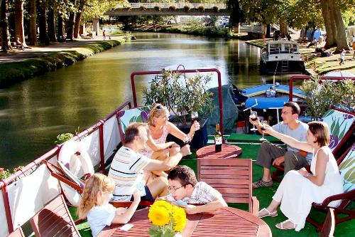 A family enjoys a trip through France aboard the European Waterways barge Rosa.