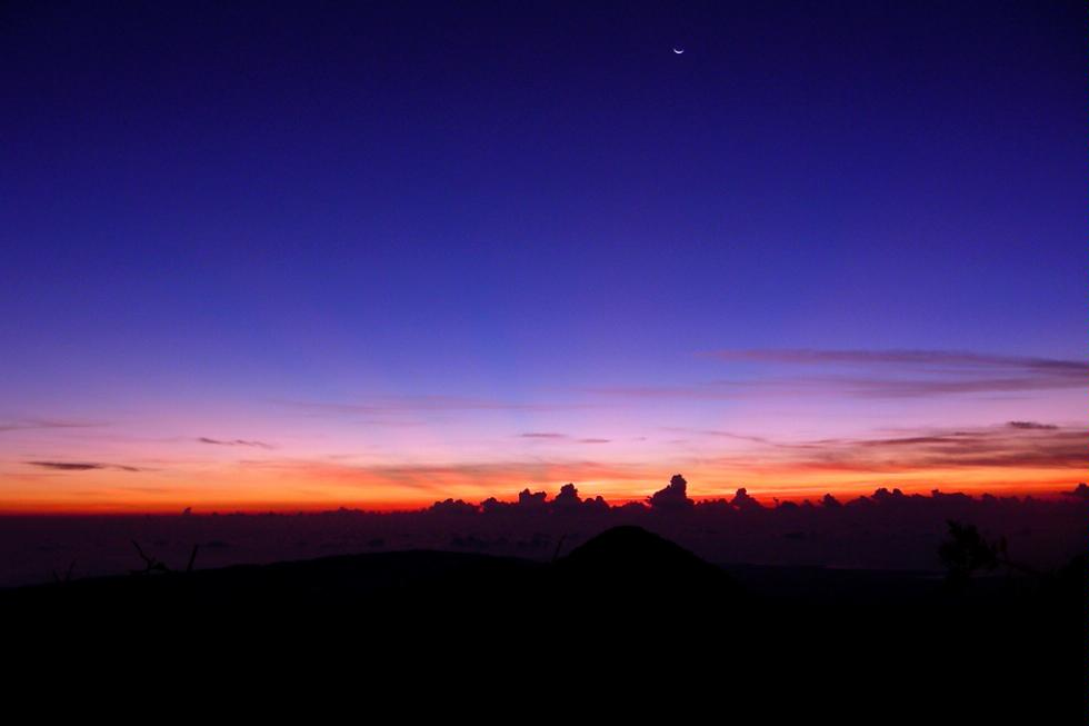 Watching the sun rise from Blue Mountain peak in Jamaica.