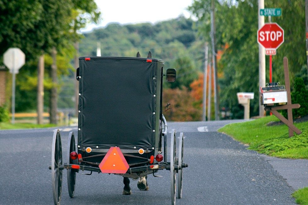 An Amish horse & buggy travels through Lancaster County