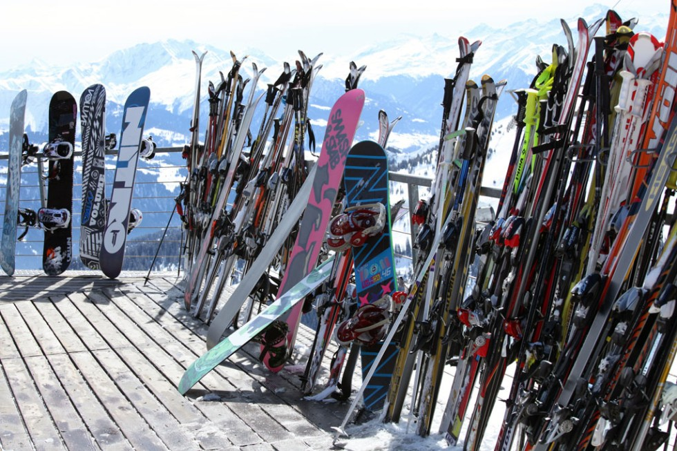 Skis and snowboards at winter resort in Laax, Switzerland.