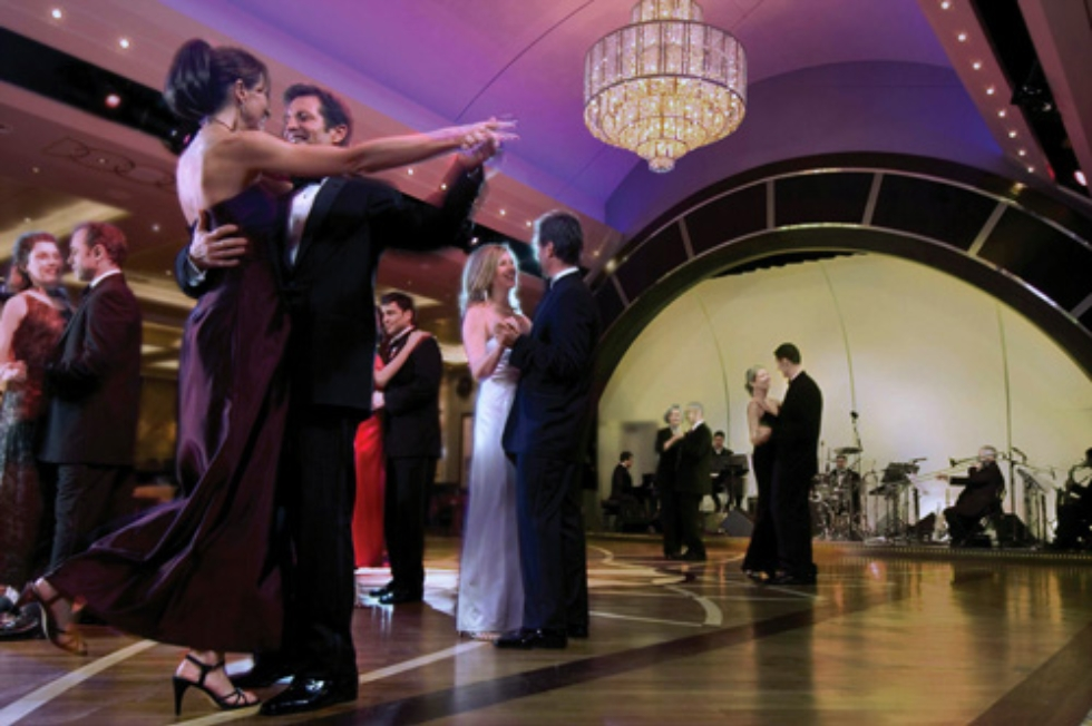 Guests dancing in the Queen Mary 2 Queens Room.
